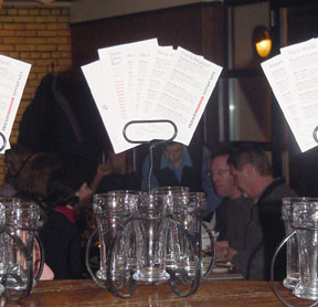 Beer glasses in caddies with menus, awaiting sampling at Bier Markt